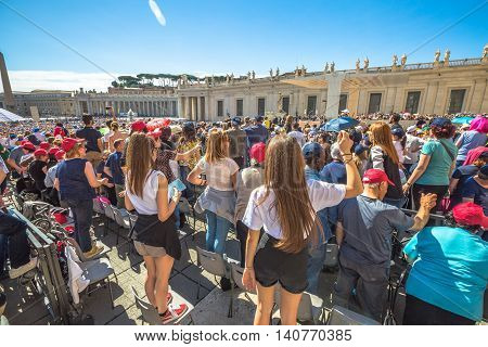 Rome, Italy - June 18, 2016: close up of people while you listen to Pope Francesco speaking for jubilee event in St. Peter's Square, Vatican.