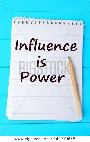 The words Influence is power written on notebook