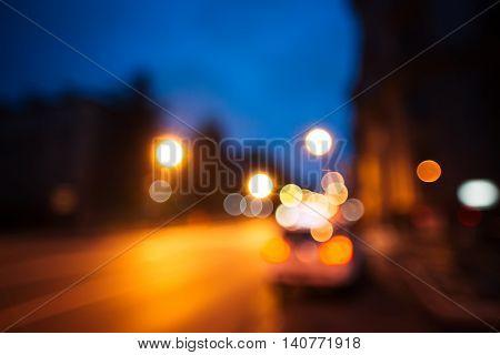 City road motion blur. Night background. Bokeh effect. Flashing lights. Motion on street.