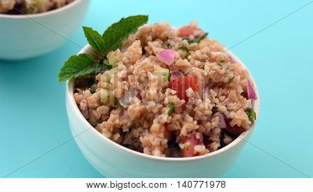 Closeup of Tabouleh, sometimes spelled Tabbouleh: A traditional Middle Eastern salad made with bulgur wheat.
