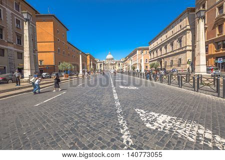Rome, Italy - June 18, 2016: people walking on the Conciliazione Road to San Pietro square for from Pia square.