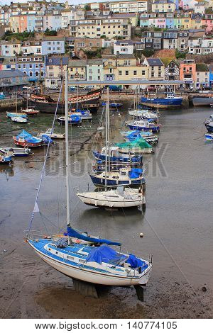 Brixham, Devon, Uk, Nov 02 2015: Small Boats Moored At Low Tide In The Fishing Port With The Replica