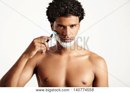 Shaving Man Watching At Camera With A Serious Face