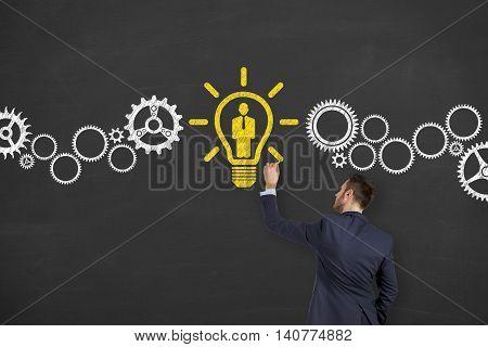 Human Resource Idea Light Bulb Drawing on Blackboard Businessman Working Conceptual