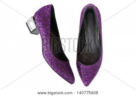Top view of purple magenta high-heeled shoes with glitters. A new pair of stylish sparkling beautiful shoes for ladies isolated on white background