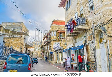 HAIFA ISRAEL - FEBRUARY 20 2016: The streets of Wadi Nisnas become empty and quiet after the closing of Arab Market on February 20 in Haifa.