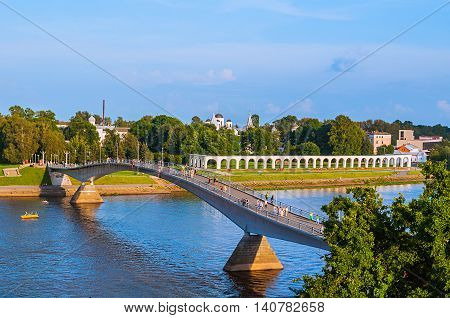 VELIKY NOVGOROD RUSSIA-JULY 29 2016. Birds eye view of Yaroslav Courtyard and footbridge across the Volkhov river in summer sunny evening in Veliky Novgorod Russia- architecture landscape