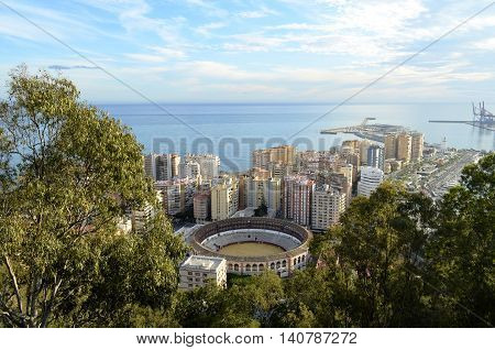 Aerial view of the La Malagueta neighbourhood in Malaga (Andalusia, Spain), with its bullring and harbour.