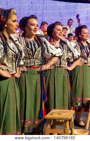 ROMANIA TIMISOARA - JULY 8 2016: Romanian dancers in traditional costume present at the international folk festival