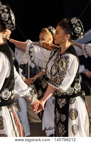 ROMANIA TIMISOARA - JULY 7 2016: Romanian dancers in traditional costume present at the international folk festival
