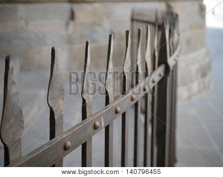 an old iron gate with spears tipped
