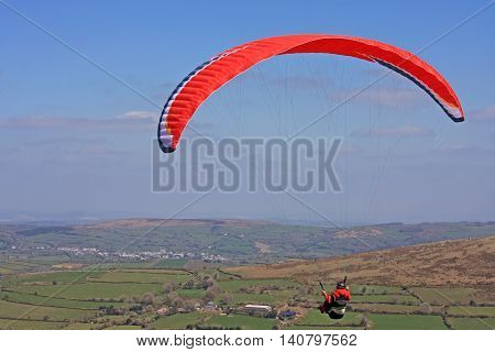 Paraglider flying wing above Dartmoor in Devon
