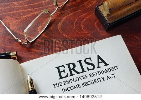 Page with ERISA The Employee Retirement Income Security Act of 1974  on a table.