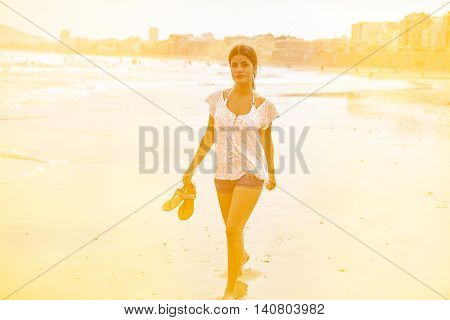 Pretty Young Girl In The Breaking Waves