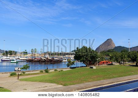 RIO DE JANEIRO - March 21: Ships and yachts in Marina da Gloria witn mountain Sugarloaf on background on March 21 2016 in Rio de Janeiro. It is the base for the sailing competitions taking place in the waters of Guanabara Bay