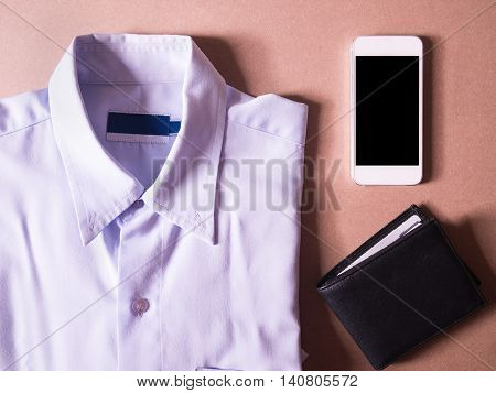 business clothes set of white smart phone and balck wallet in concept new employees