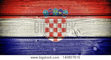 Flag of Croatia painted on old grungy wooden background