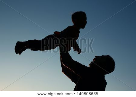 very nice silhouette of father and son