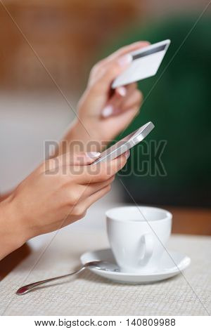 Woman hands holding mobile phone and credit card. Female hands making online payment. Purchase and Buy online. Online shopping