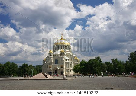 SAINT- PETERSBURG - JUNE 09: Naval cathedral in Kronshtadt on June 09 2013 Saint-Petersburg Russia. Crowd of tourists on the square in front of Naval cathedral in Kronshtadt Saint Petersburg Russia
