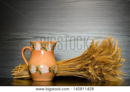 Pitcher and a sheaf on a black background with space for text