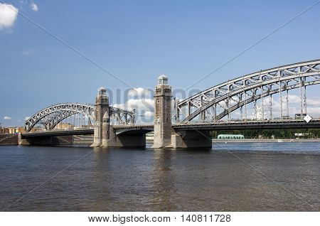 Bolsheokhtinsky bridge across Neva River in summer day also known as Peter the Great Bridge Saint-Petersburg Russia