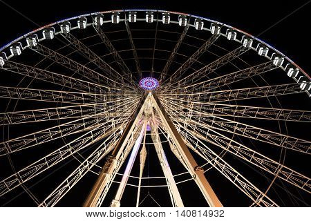 Parisian Ferris wheel in high contrast at night