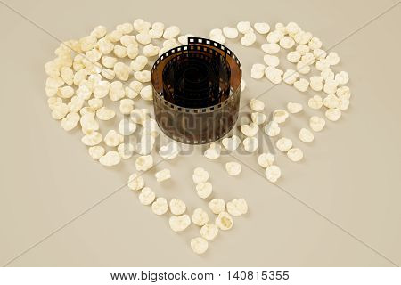 Movie lovers concept with rolled film strip and popcorn shaped into a heart. 3D Rendering