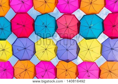 Colorful umbrellas in the sky. Street decoration in the sity