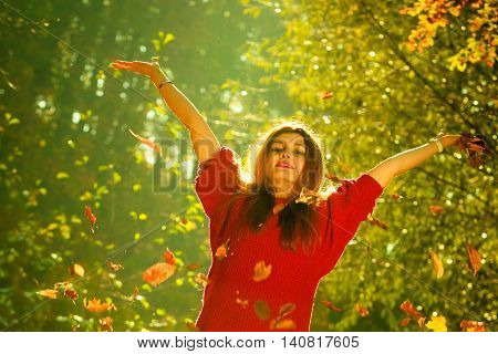 Woman Playing With Autumnal Leaves.