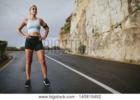 Female Athlete Taking A Break From Running