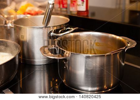 aluminium and metallic pans and cookware on kitchen