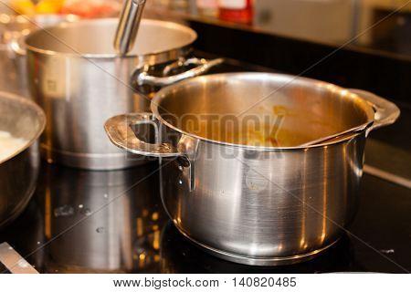 aluminium metallic pans and cookware on kitchen