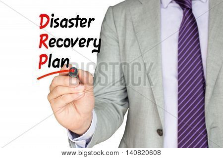Businessman with a purple tie underlining disaster recovery plan with a red pen on white