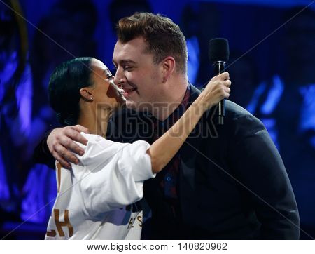 NEW  YORK-NOV 13: Nicole Richie (L) congratulates Sam Smith after winning Artist of the Year at VH1's 'You Oughta Know In Concert' 2014 at Hammerstein Ballroom on November 13, 2014 in New York City.