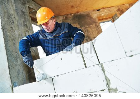 bricklayer at work with silicate brick