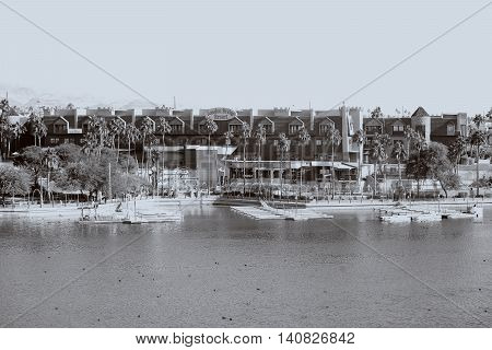 LAKE HAVASU CITY, UNITED STATES - DECEMBER 23: The shores of Lake Havasu at the London Bridge Resort with a boardwalk and jetties on December 23, 2015 in Lake Havasu City.