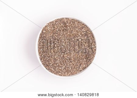 Chia seed into a bowl on white background