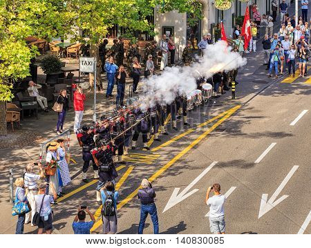 Zurich, Switzerland - 1 August, 2016: participants of the parade devoted to the Swiss National Day shooting. The Swiss National Day is the national holiday of Switzerland, set on 1 August.