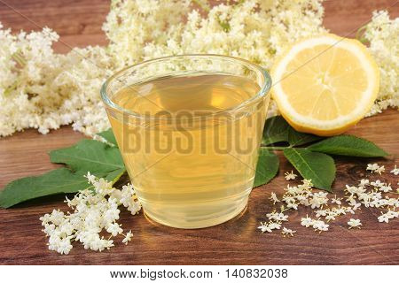 Fresh Healthy Juice, Elderberry Flowers And Lemon On Rustic Board
