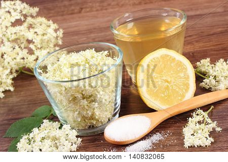 Flowers And Juice Of Elderberry, Ingredients For Preparing Beverage On Rustic Board