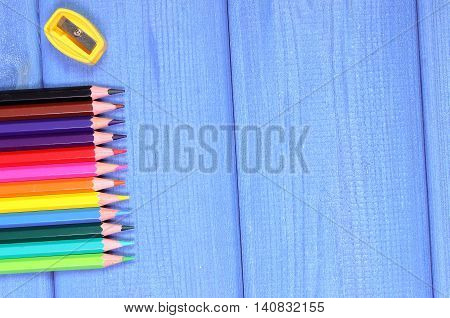 Colorful Crayons And Sharpener On Boards, School Accessories, Copy Space For Text