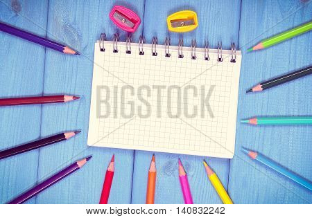 Vintage Photo, Colorful Crayons, Sharpener And Notepad On Boards, School Accessories, Copy Space For