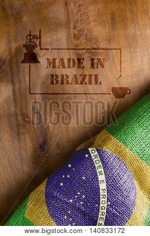 The predominant industry in Brazil - coffee. Flag of Brazil and hot stamp on wood Made in Brazil with a cup of coffee.