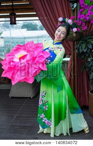 Beautiful Chinese Woman In Green Traditional Dress And Floral Parasol