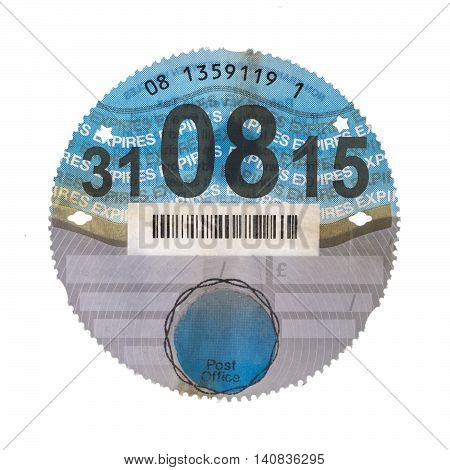 SWINDON UK - AUGUST 2 2016: Old UK Car Tax Disk on a White Background
