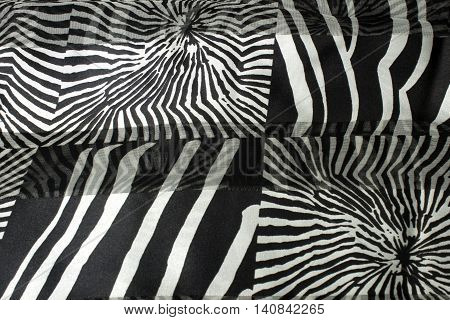 This is a photograph of a Silver and Black animal print polyester fabric scarf
