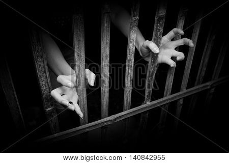 Female Hands with cage cell. trafficking Concept