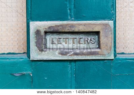 communication, correspondence, mail and post service concept- close up of vintage mailbox