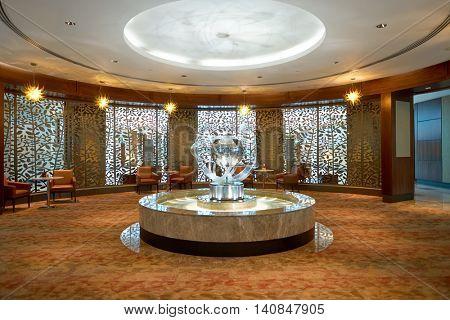 DUBAI, UAE - MAY 13, 2016: interior of business lounge in Dubai International Airport. Dubai International Airport is the primary airport serving Dubai, United Arab Emirates.
